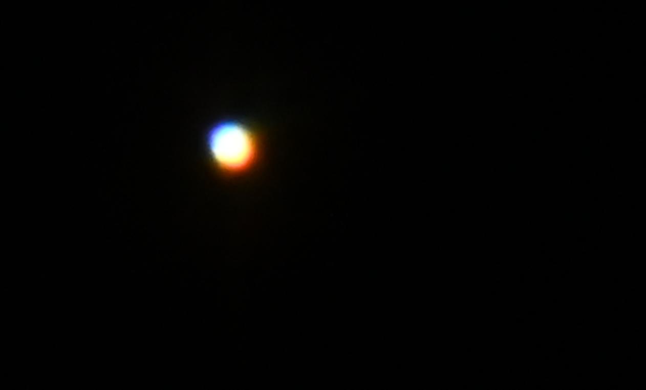 A bright white circle against a dark background
